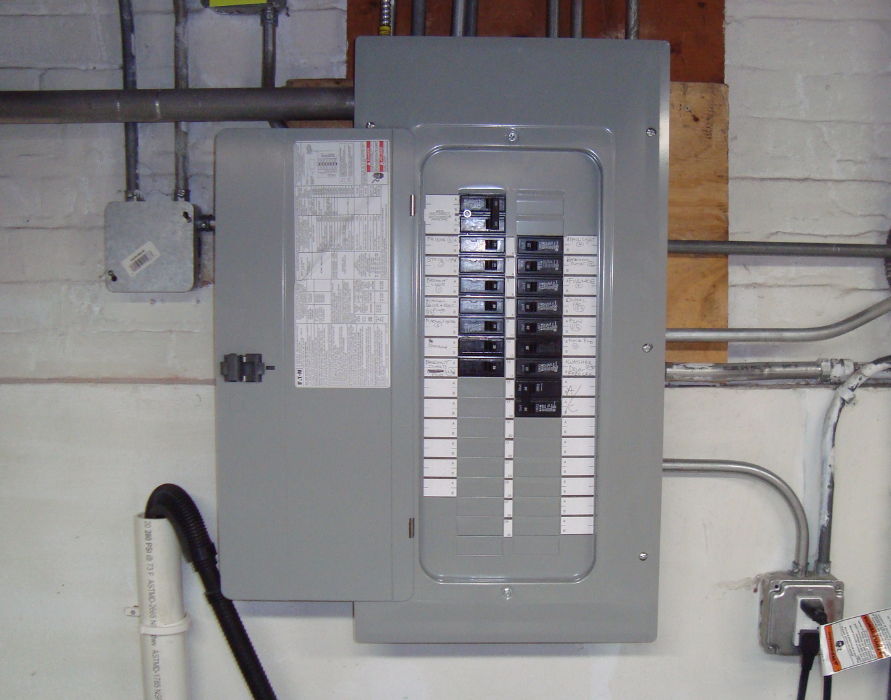 100 amp service upgrade with a 30 position circuit breaker panel